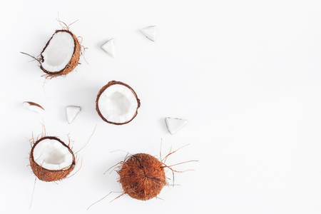 Coconut background. Fresh coconuts on white background. Flat lay, top view, copy space