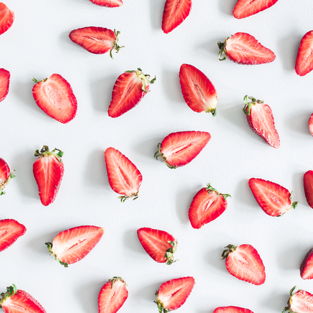 Strawberry pattern on pastel blue background. Summer concept. Flat lay, top view, square