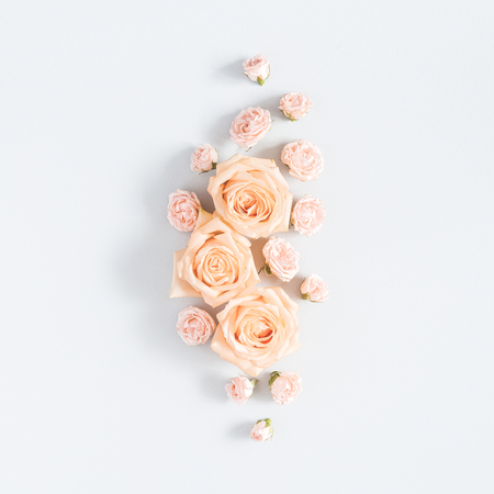 Flowers composition. Pattern made of beige rose flowers on pastel gray background. Flat lay, top view, square