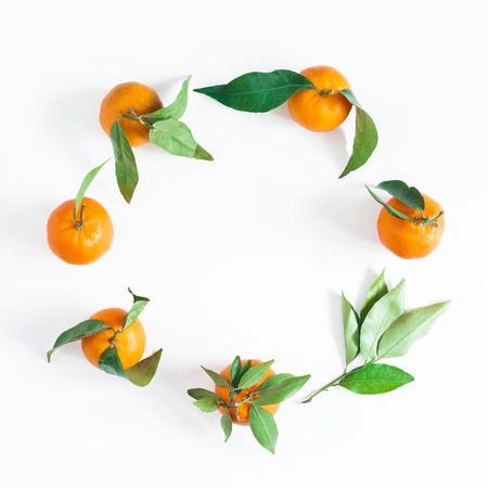 Mandarins on white background. Flat lay, top view, copy space, square