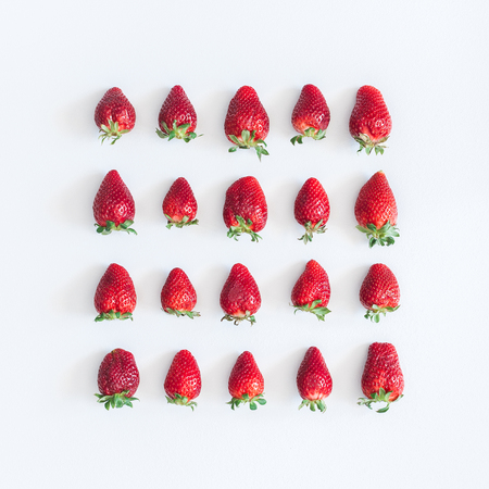 Strawberry pattern on gray background. Flat lay, top view, square