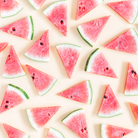Watermelon pattern. Red watermelon on pastel yellow background. Summer concept. Flat lay, top view, square