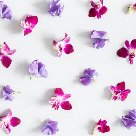 Flowers composition. Pattern made of colorful flowers on pastel gray background. Flat lay, top view, copy space