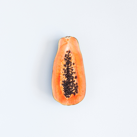 Papaya on pastel gray background. Summer concept. Flat lay, top view, square