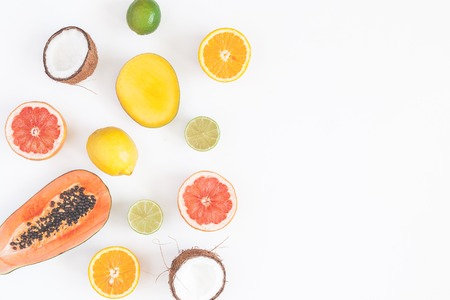 Summer tropical composition. Tropical fruits on white background. Summer concept. Flat lay, top view, copy space 版權商用圖片