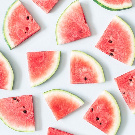 Watermelon pattern. Red watermelon on pastel blue background. Summer concept. Flat lay, top view, square