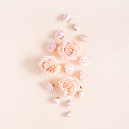 Flowers composition. Pattern made of beige rose flowers on pastel yellow background. Flat lay, top view, square