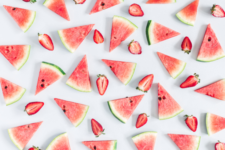 Watermelon and strawberry pattern on pastel blue background. Summer concept. Flat lay, top view 写真素材