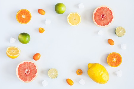 Fruit background. Colorful fresh fruits on pastel blue background. Orange, tangerine, lime, lemon, grapefruit. Summer concept. Flat lay, top view, copy space