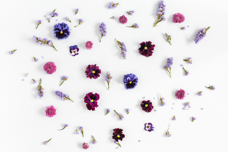 Flowers composition. Pattern made of colorful flowers on white background. Flat lay, top view, square
