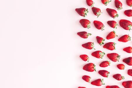 Strawberry on pastel pink background. Flat lay, top view, copy space Zdjęcie Seryjne