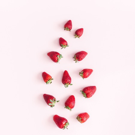 Strawberry pattern on pink background. Flat lay, top view, square 写真素材