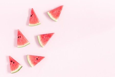 Watermelon on pastel pink background. Summer concept. Flat lay, top view, copy space