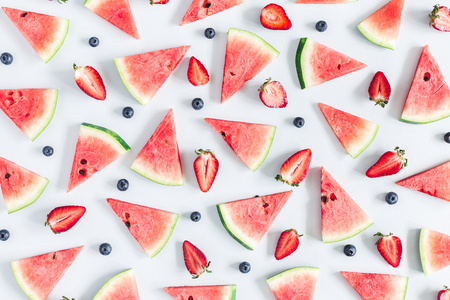 Watermelon, strawberry, blueberry pattern on pastel blue background. Summer concept. Flat lay, top view