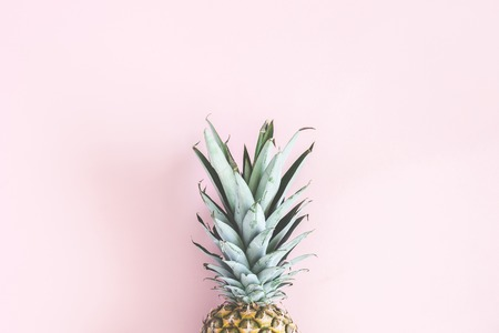 Pineapple on pastel pink background. Summer concept. Flat lay, top view