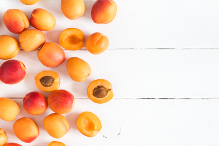 Apricots on white wooden background. Flat lay, top view, copy space 写真素材