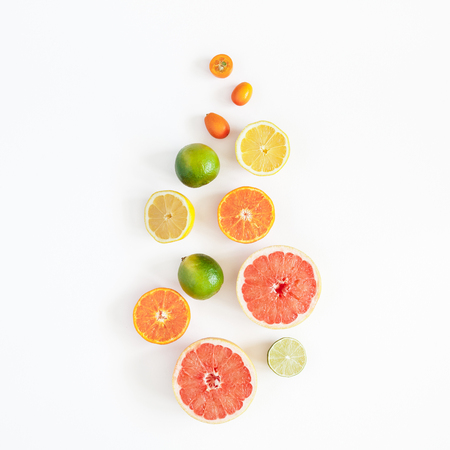 Colorful fresh fruits on pastel white background. Orange, tangerine, lime, lemon, grapefruit. Summer concept. Flat lay, top view, square