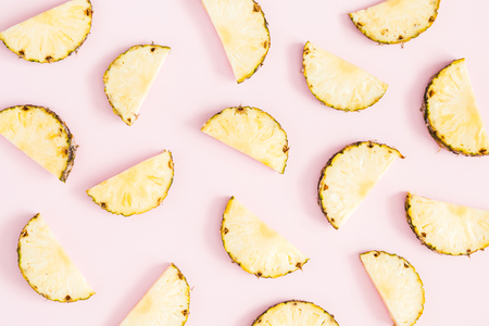 Pineapples on pastel pink background. Summer concept. Flat lay, top view