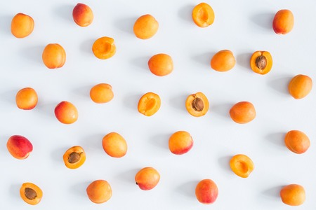 Apricots on pastel blue background. Flat lay, top view