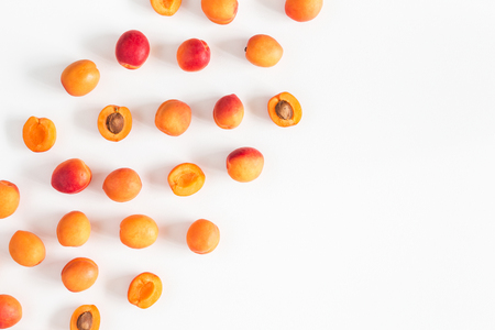 Apricots on white background. Flat lay, top view, copy space