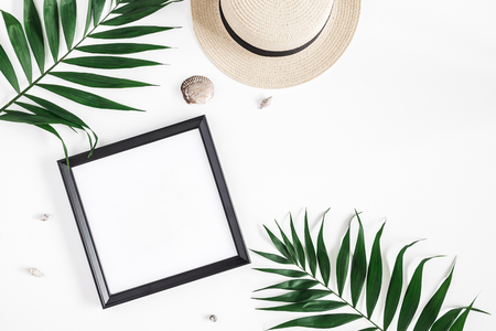 Summer composition. Tropical palm leaves, hat, photo frame, coconut on white background. Summer concept. Flat lay, top view, copy space