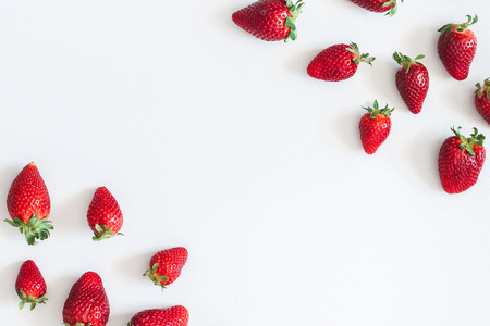 Strawberry pattern on blue background. Flat lay, top view, copy space