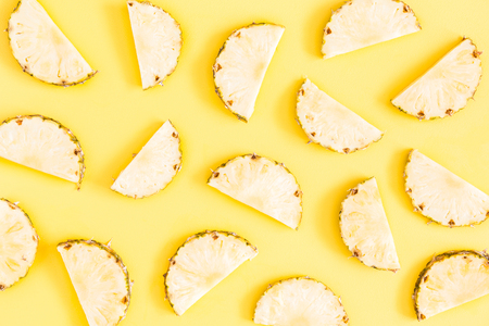 Pineapples on yellow background. Summer concept. Flat lay, top view