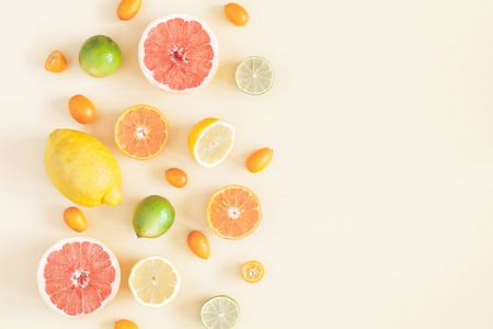 Summer fruits on pastel yellow background. Summer concept. Flat lay, top view, copy space Stockfoto