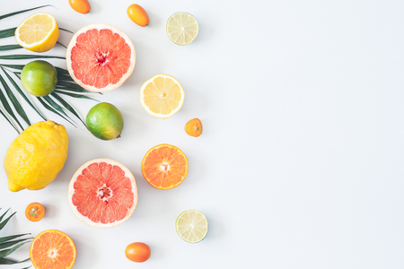 Fruit background. Colorful fresh fruits and tropical palm leaves on pastel blue background. Summer concept. Flat lay, top view, copy space Stockfoto