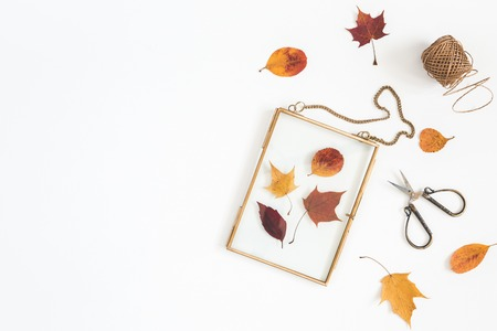 Autumn composition. Workspace with frame, autumn leaves. Flat lay, top view, copy space