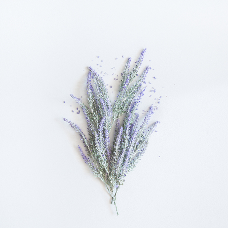 Lavender flowers bouquet on pastel gray background. Flat lay, top view, square