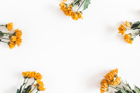 Autumn composition. Frame made of fresh orange flowers on white background. Autumn, fall concept. Flat lay, top view, copy space