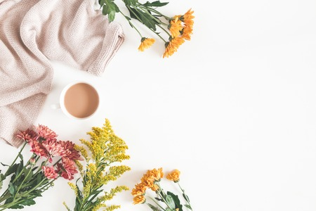 Autumn composition. Cup of coffee, fresh flowers on white background. Autumn, fall concept. Flat lay, top view, copy space Stock Photo