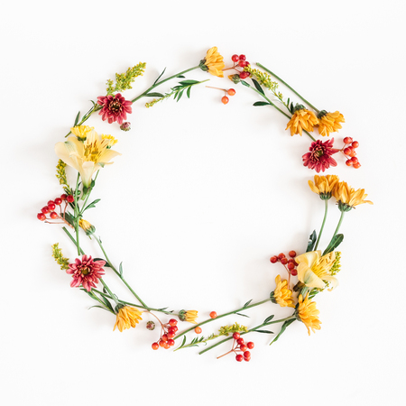 Autumn floral composition. Wreath made of fresh flowers on white background. Autumn, fall concept. Flat lay, top view, copy space, square