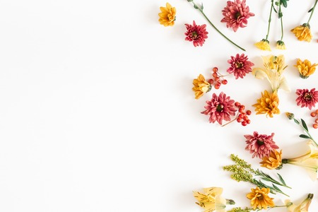 Autumn floral composition. Frame made of fresh flowers on white background. Autumn, fall concept. Flat lay, top view, copy space Stock Photo