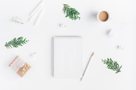 Christmas composition. Cup of coffee, notebook, thuja branches on white background. Christmas, winter, new year concept. Flat lay, top view, copy space Stock Photo