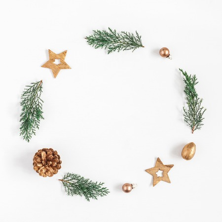 Christmas composition. Christmas wreath made of fir branches, balls, pine cones on white background. Flat lay, top view, copy space, square Stock Photo