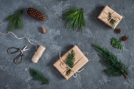 Gifts, different winter plants on black background. Flat lay, top view Stock Photo
