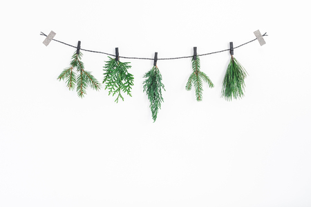 Christmas composition. Christmas garland made of conifer tree branches on white background. Flat lay, top view, copy space