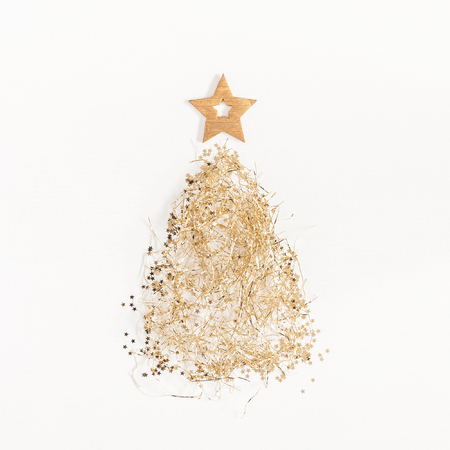 Christmas tree made of golden confetti. Christmas, winter, new year concept. Flat lay, top view, square Stock Photo
