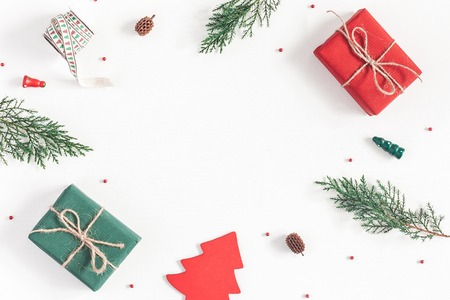 Christmas composition. Frame made of christmas gifts, pine branches, toys on white background. Flat lay, top view, copy space Stock Photo
