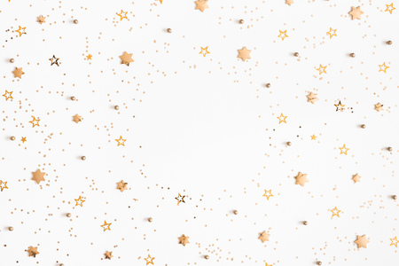 Christmas composition. Christmas golden decorations on white background. Flat lay, top view, copy space Foto de archivo