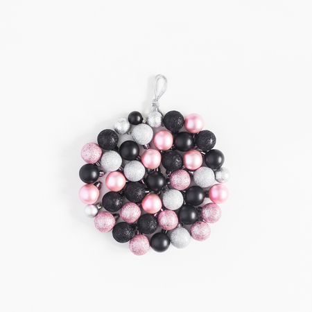 Christmas ball made of black, silver and pink balls on white background. Christmas, winter, new year concept. Top view, flat lay, square