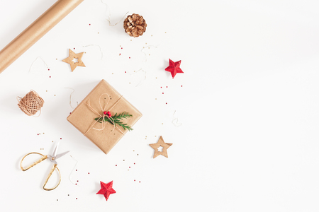 Christmas composition. Christmas gifts, conifer branches, red and golden decorations on white background. Flat lay, top view, copy space