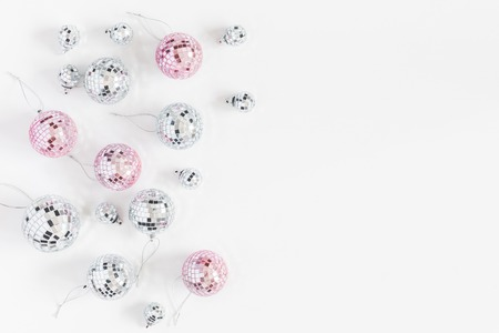 Christmas composition. Christmas balls, pink and silver decorations on white background. Flat lay, top view, copy space Stok Fotoğraf