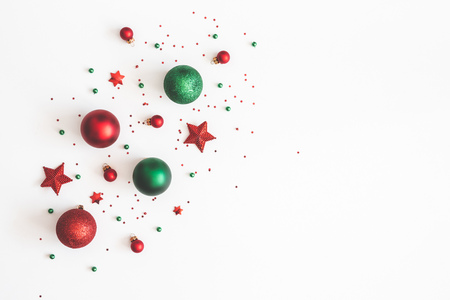 Christmas composition. Christmas red and green decorations on white background. Flat lay, top view, copy space