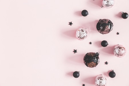 Christmas composition. Christmas pink and black decorations on pastel pink background. Flat lay, top view, copy space Stock Photo