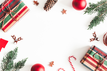 Christmas composition. Christmas gifts, fir tree branches, decorations on white background. Flat lay, top view, copy space Stock Photo