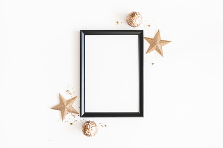 Christmas composition. Photo frame, golden decorations on white background. Christmas, winter, new year concept. Flat lay, top view, copy space 스톡 콘텐츠