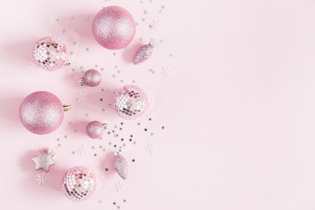 Christmas composition. Christmas pink decorations on pastel pink background. Flat lay, top view, copy space
